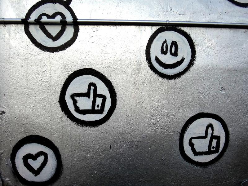 social media likes on a wall