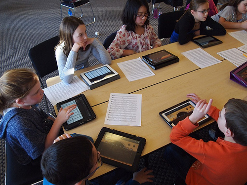 Students using mobile devices in classroom