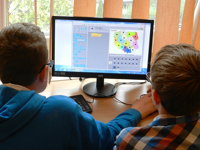 Students playing computer-simulated game