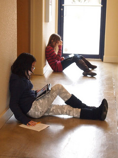 Children in hallway reading from their iPads