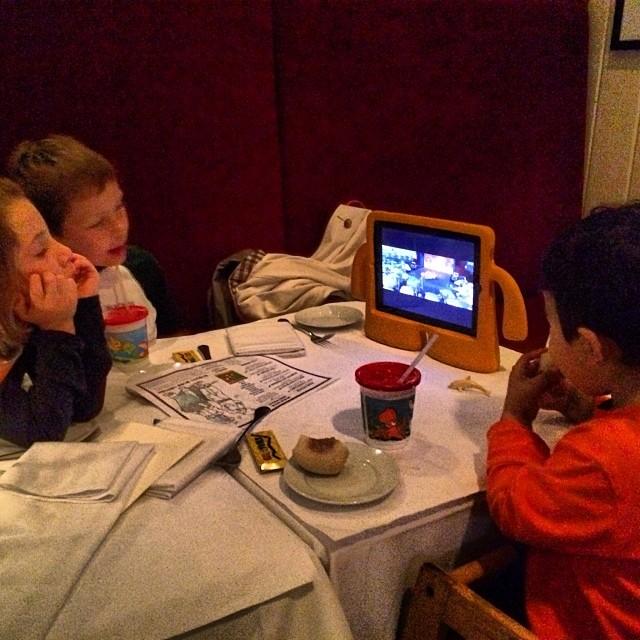 Kids watching iPad over dinner