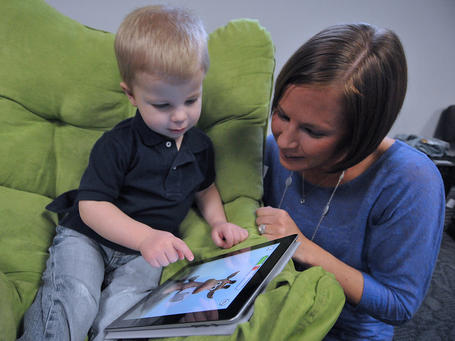 Mother and child with iPad