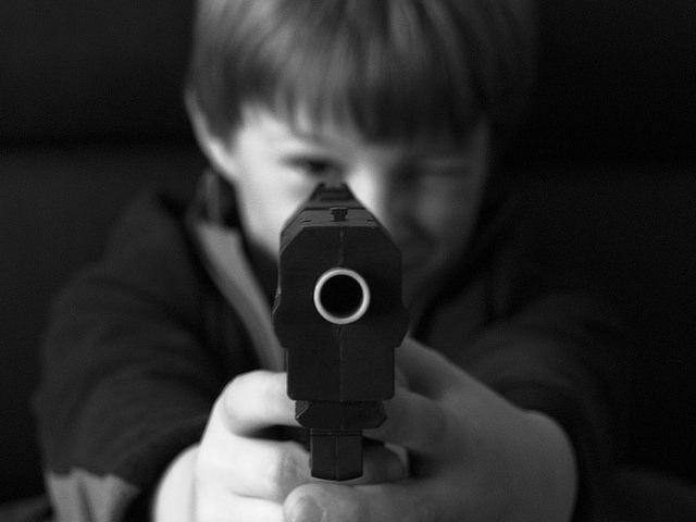 Kid holding toy gun