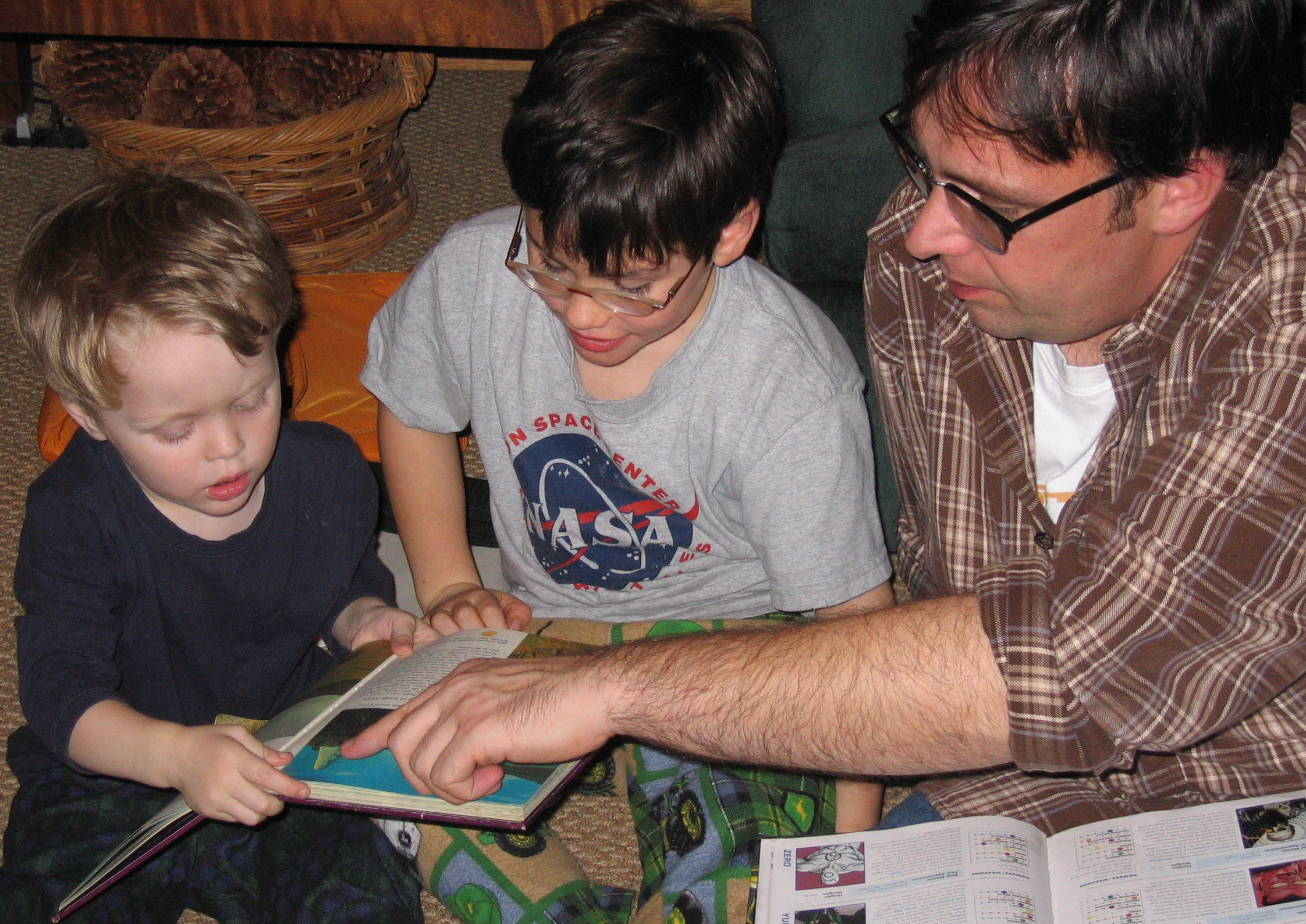 Father teaching his children to read